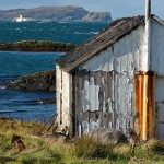 Fishermans Shed with Fladda Lighthouse behind